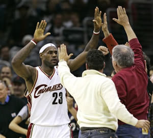 LeBron James high fiving fans